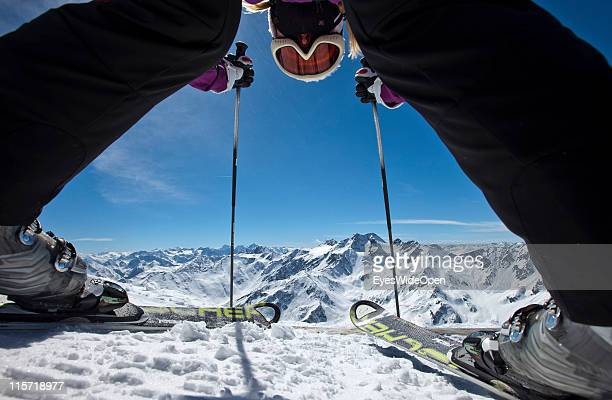 Panoramic view through the tips of a pair of skis in the glacier skiing area of Val Senales on April 05 2011 in Merano Italy Val Senales is a glacier...