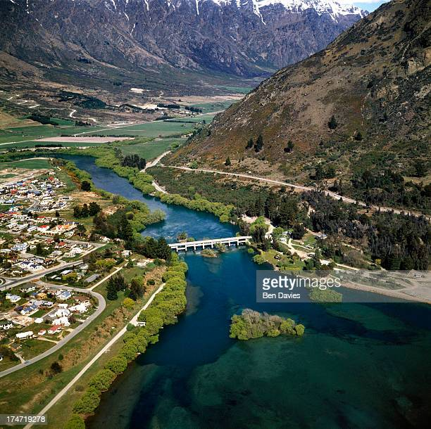 Panoramic views over the Shotover River to the city of Queenstown and the nearby snowcapped mountains such as The Remarkables Cecil Peak and the...