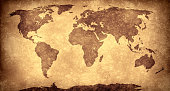 Brown panoramic World map on old paper, in grunge vignetted effect. XXXL size concept image, digitally generated.