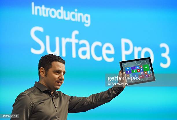 Panos Panay corporate vice president with Microsoft's Surface division holds the new Microsoft Surface Pro 3 tablet computer during a press...