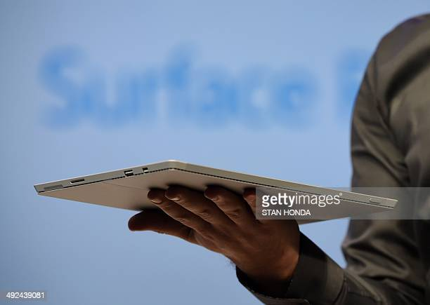 Panos Panay corporate vice president with Microsoft's Surface division holds the new Microsoft Surface Pro 3 tablet during a press conference May 20...