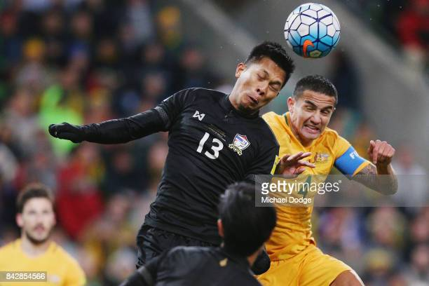 Pansa Hemviboon of Thailand heads the ball away from Tim Cahill of the Socceroos during the 2018 FIFA World Cup Qualifier match between the...