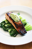 Pan-seared salmon with bok choy and cilantro aioli