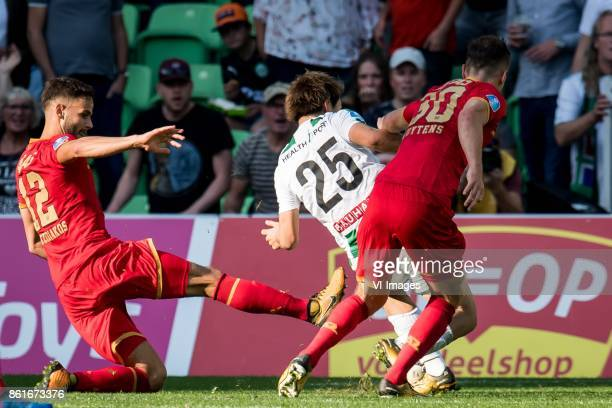 Pantelis Hatzidiakos of AZ Ritsu Doan of FC Groningen Mats Seuntjens of AZ foul penalty during the Dutch Eredivisie match between FC Groningen and AZ...