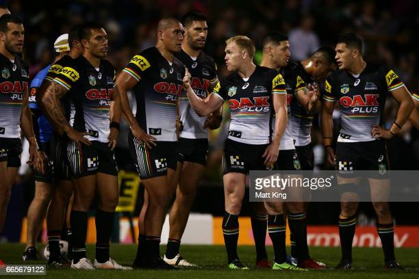 Panthers captain Peter Wallace talks to Panthers players as they look dejected after a Rabbitohs try during the round six NRL match between the...