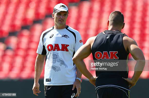 Panthers coach Ivan Cleary talks with Lewis Brown during a Penrith Panthers NRL training session at Sportingbet Stadium on March 19 2014 in Sydney...