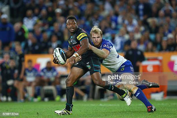 Panthers James Segeyaro is tackled by Bulldogs Aiden Tolman during the Preliminary Final at ANZ Stadium Sydney Australia Saturday 27th September 2014
