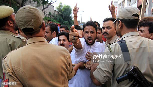 Panthers party workers shout slogans during a shutdown on October 10 2015 in Jammu India Life in Jammu was affected on Saturday by a protest shutdown...