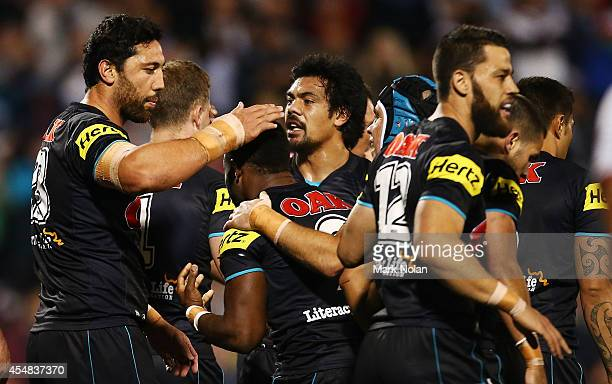 Panthers players celebrate a try by James Segeyaro during the round 26 NRL match between the Penrith Panthers and the New Zealand Warriors at...