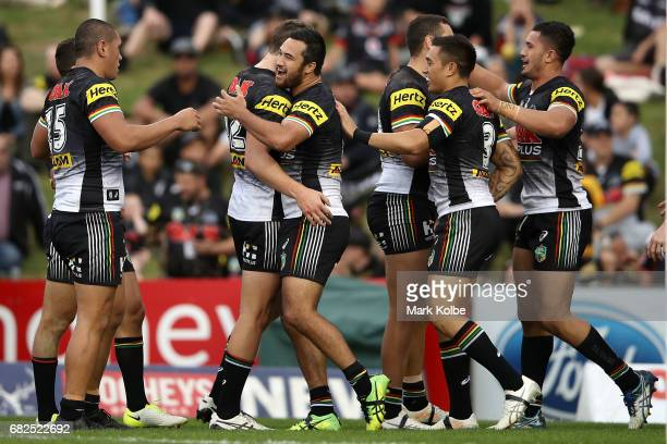 Panthers players celebrate Waqa Blake scoring a try during the round 10 NRL match between the Penrith Panthers and the New Zealand Warriors at Pepper...