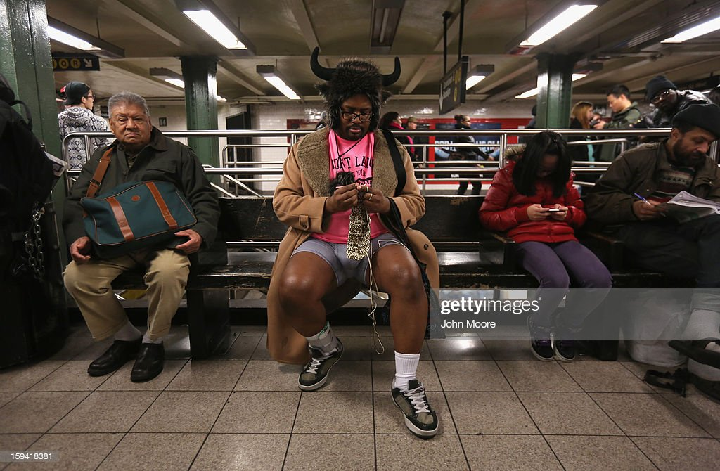 A pantless man knits at the Union Square subway station on January 13, 2013 in New York City. Thousands of people participated in the 12th annual No Pants Subway Ride, organized by New York City prank collective Improv Everywhere. During the afternoon winter event, participants boarded separate subway stops and removed their pants, pretending that they did not know each other. The event, refered to as a 'celebration of silliness' is designed to make fellow subway riders laugh and smile.