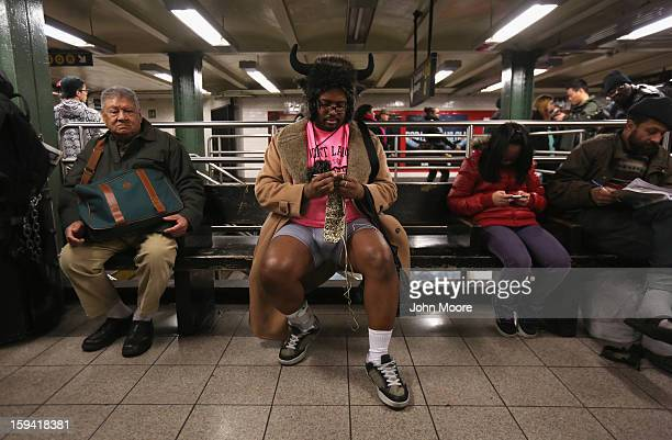 A pantless man knits at the Union Square subway station on January 13 2013 in New York City Thousands of people participated in the 12th annual No...