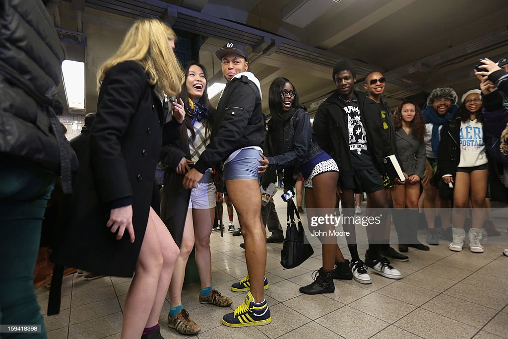 Pantless people pose for photos at the Union Square subway station on January 13, 2013 in New York City. Thousands of people participated in the 12th annual No Pants Subway Ride, organized by New York City prank collective Improv Everywhere. During the afternoon winter event, participants boarded separate subway stops and removed their pants, pretending that they did not know each other. The event, refered to as a 'celebration of silliness' is designed to make fellow subway riders laugh and smile.