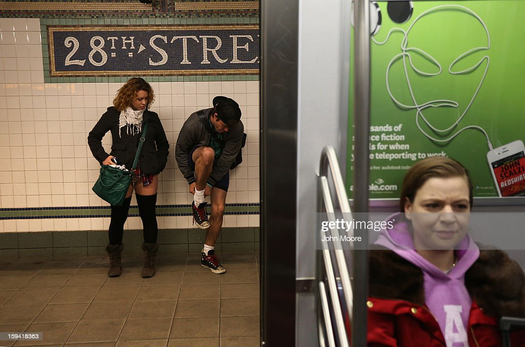 Pantless people stand on a subway platform on January 13, 2013 in New York City. Thousands of people participated in the 12th annual No Pants Subway Ride, organized by New York City prank collective Improv Everywhere. During the afternoon winter event, participants boarded separate subway stops and removed their pants, pretending that they did not know each other. The event, refered to as a 'celebration of silliness' is designed to make fellow subway riders laugh and smile.