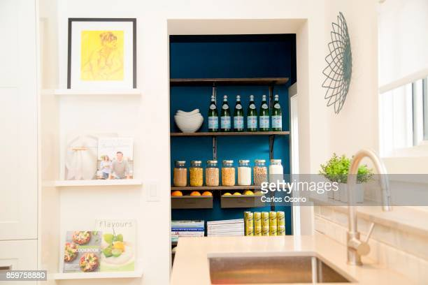 TORONTO ON SEPTEMBER A pantry next to the kitchen Tessa Steenstra and her husband Andy Saavedra pose for a photograph with their kids Mattias...