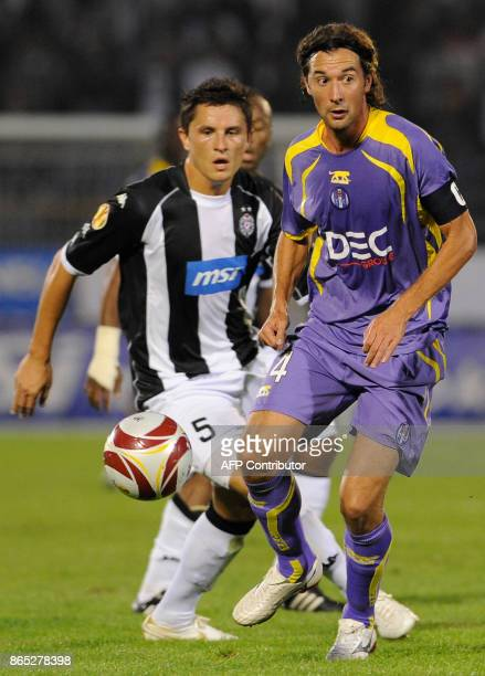 Pantxi Sirieix of Toulouse FC vies with Ljubomir Fejsa of Partizan Belgrade during their UEFA Europa League group J football match in Belgrade on...