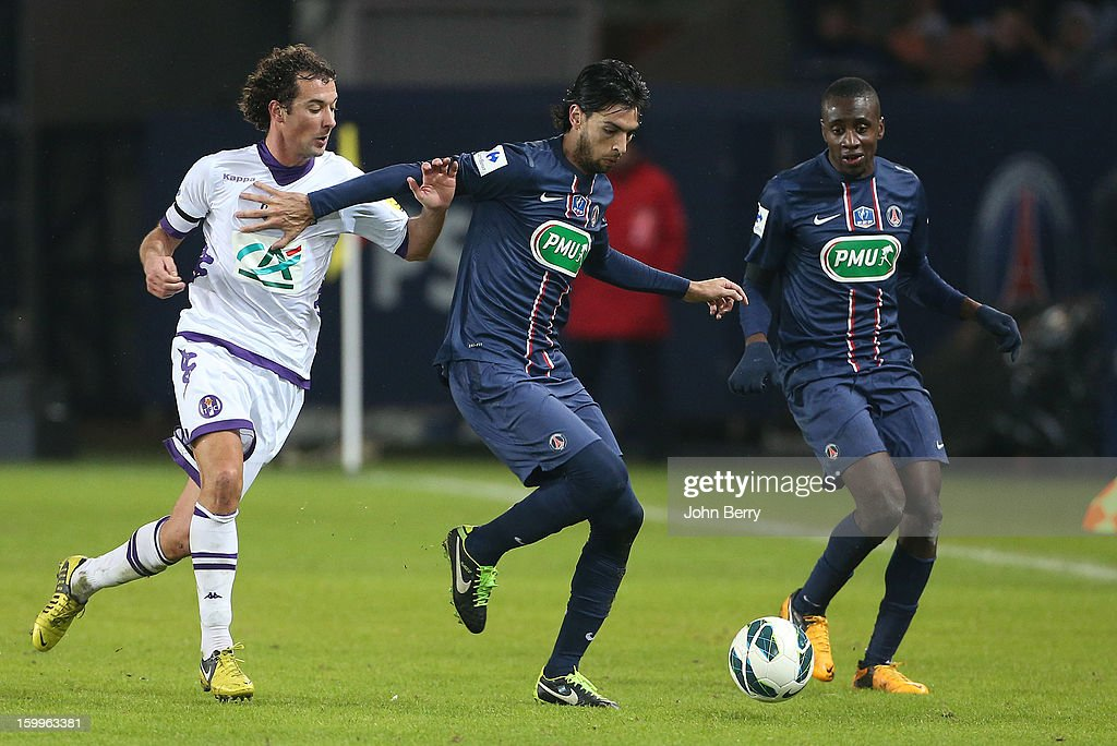 Pantxi Sirieix of Toulouse (L) pursues Javier Pastore (C) and Blaise Matuidi of PSG in action during the French Cup match between Paris Saint Germain FC and Toulouse FC at the Parc des Princes stadium on January 23, 2013 in Paris, France.