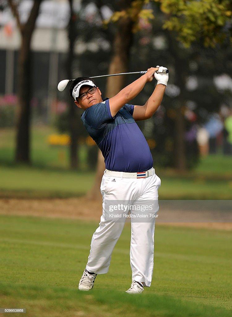 Panuphol Pittayarat of Thailand plays a shot during round four of the Bashundhara Bangladesh Open at Kurmitola Golf Club on February 13, 2016 in Dhaka, Bangladesh.