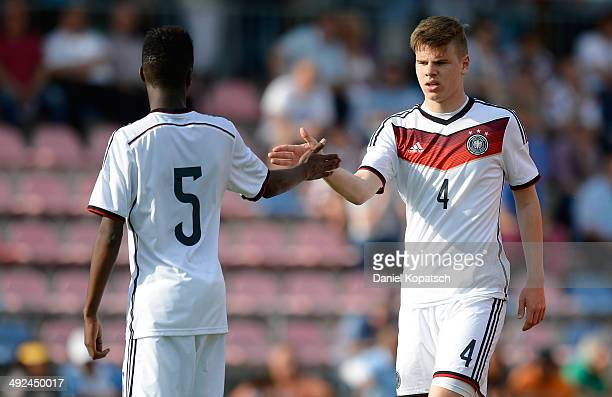 Panzu Ernesto of Germany and Florian Baak of Germany react during the international friendly U15 match between Germany and Netherlands on May 20 2014...