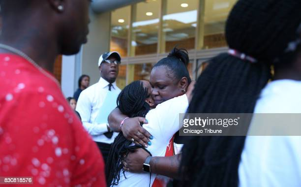 Panzy Edwards right hugs a supporter outside police headquarters on Thursday Aug 10 in Chicago Panzy Edwards's son Dakota Bright was fatally shot by...