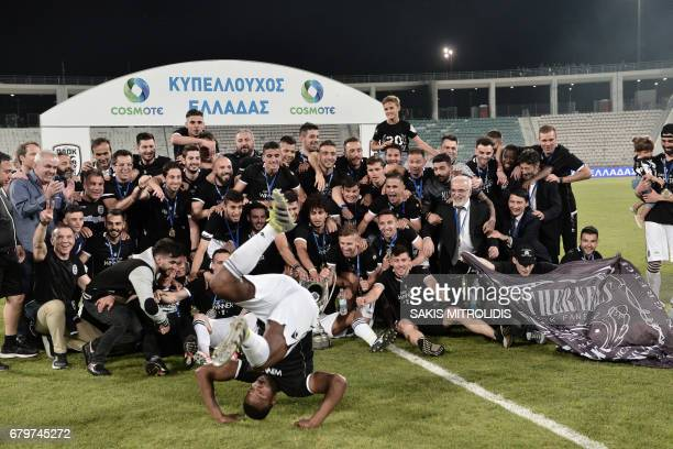 Paok Thessaloniki players celebrate with the trophy after winning the Greek Cup final football match between AEK Athens and PAOK Thessaloniki in...