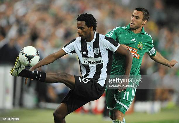 Paok Thessaloniki's Lino vies for the ball with Rapid Vienna's Steffen Hofmann during their UEFA Europa League qualifying football match on August...