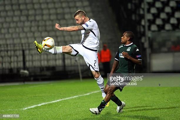Paok's Greek defender Giannis Skondras vies for the ball with Krasnodar's Brazilian midfielder Joaozinho during the UEFA Europa League football match...