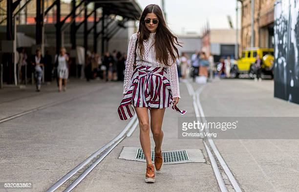 Paola Alberdi wearing a white Kindred blouse a red blue white striped skirt from Finders Keepers a brown Chloe bag and brown Stella McCartney...