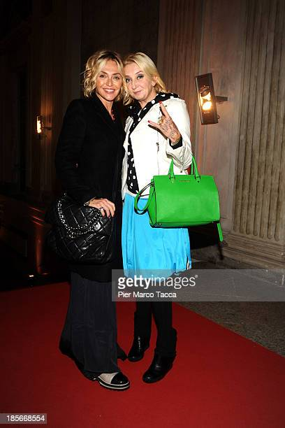 Paola Barale and la Pina attend the 'Warhol' exhibition opening at Palazzo Reale on October 23 2013 in Milan Italy