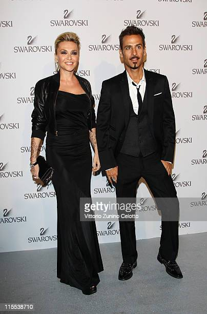 Paola Barale and Raz Degan attend the Swarovski Fashionation at Palazzo Reale on June 7 2011 in Milan Italy