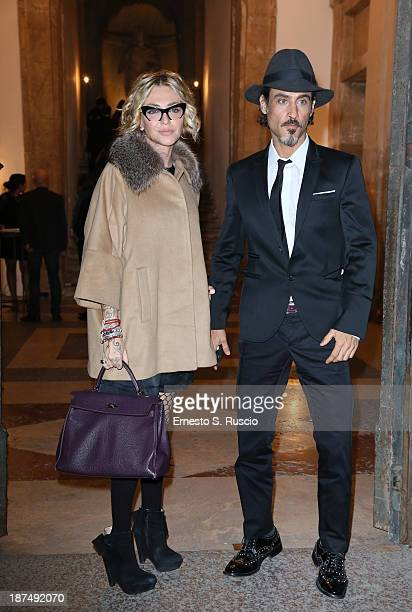 Paola Barale and Raz Degan attend the Vanity Fair Dinner at the 8th Rome Film Festival at Villa Medici on November 9 2013 in Rome Italy