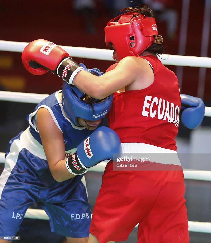 Paola Concha Calampa (blue) of Peru competes with Jessica Centeno Centeno (red) of Ecuator during the Women's 51kg Boxing Qualifications as part of the I ODESUR South American Youth Games at Coliseo Miguel Grau on September 22, 2013 in Lima, Peru.
