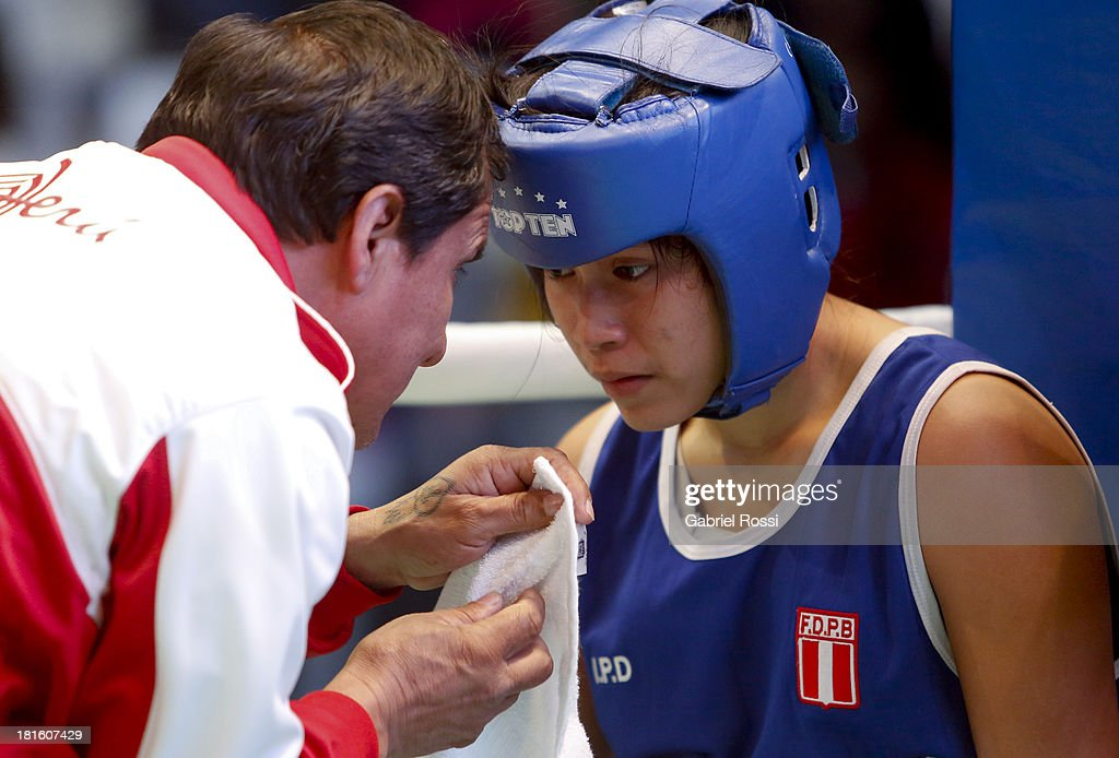 Paola Concha Calampa (blue) of Peru rests in the corner during the Women's 51kg Boxing Qualifications as part of the I ODESUR South American Youth Games at Coliseo Miguel Grau on September 22, 2013 in Lima, Peru.