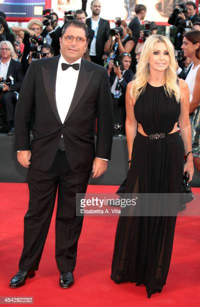 Paola Ferrari and husband Marco De Benedetti attend the Opening Ceremony and 'Birdman' premiere during the 71st Venice Film Festival on August 27...