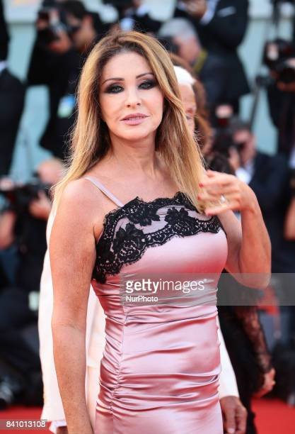 Paola Ferrari walks the red carpet ahead of the 'Downsizing' screening and Opening Ceremony during the 74th Venice Film Festival at Sala Grande on...