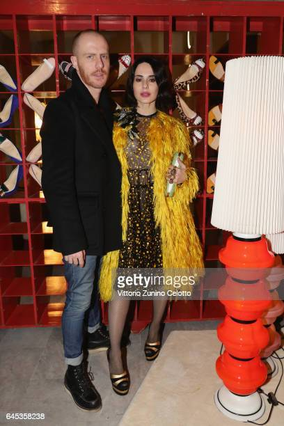 Paola Iezzi and Paolo Santambrogio attend Christian Louboutin Cocktail during Milan Fashion Week Fall/Winter 2017/18 on February 25 2017 in Milan...