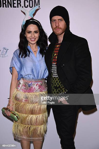 Paola Iezzi and Paolo Santambrogio attend the Vogue Talent's Cornercom on February 25 2015 in Milan Italy