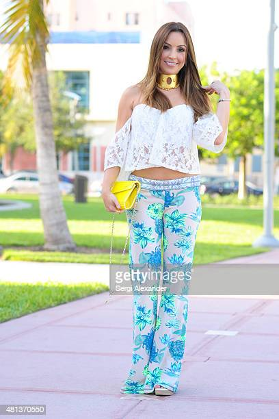 Paola Mendoza is seen wearing a top by Maaji clutch by Jimmy Choo and shoes by Gucci the during Miami Swim Week on July 19 2015 in Miami Beach Florida