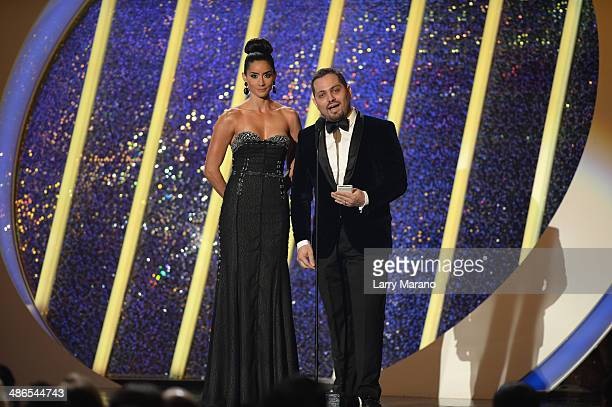 Paola Nunez and Jorge Gaxiola present onstage during the 2014 Billboard Latin Music Awards at Bank United Center on April 24 2014 in Miami Florida