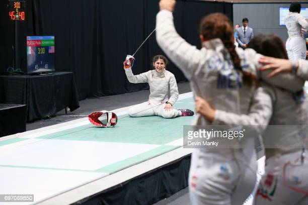 Paola Pliego of Mexico celebrates making the winning touch while teammates look on and cheer during the gold medal match in the Team Women's Sabre...