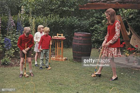 Paola Ruffo di Calabria later Queen Paola of Belgium pictured playing croquet with her children from left Prince Philippe Princess Astrid and Prince...