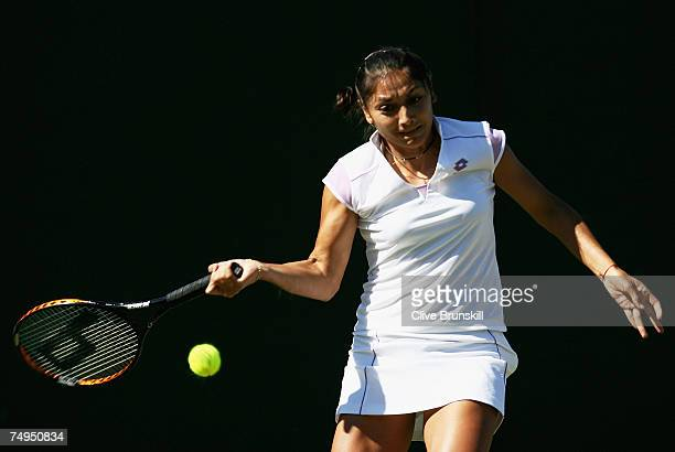 Paola Suarez of Argentina plays a forehand during the Women's Doubles first round match against Svetlana Kuznetsova of Russia and Nadia Petrova of...
