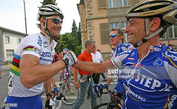 Paolo Bettini congratulates Tom Boonen of Team Quick Step winning the first stage of the 70th Tour de Suisse between Baden and Baden on June 11 2006...