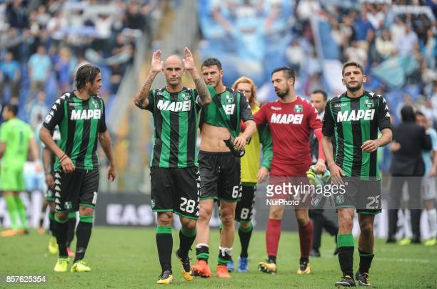 Paolo Cannavaro and Domenico Berardi of Sassuolo after the Serie A match between SS Lazio and US Sassuolo at Stadio Olimpico on October 1 2017 in...