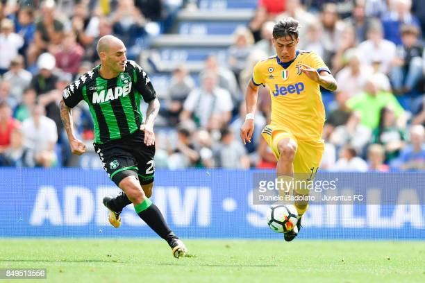 Paolo Cannavaro and Paulo Dybala during the Serie A match between US Sassuolo and Juventus at Mapei Stadium Citta' del Tricolore on September 17 2017...