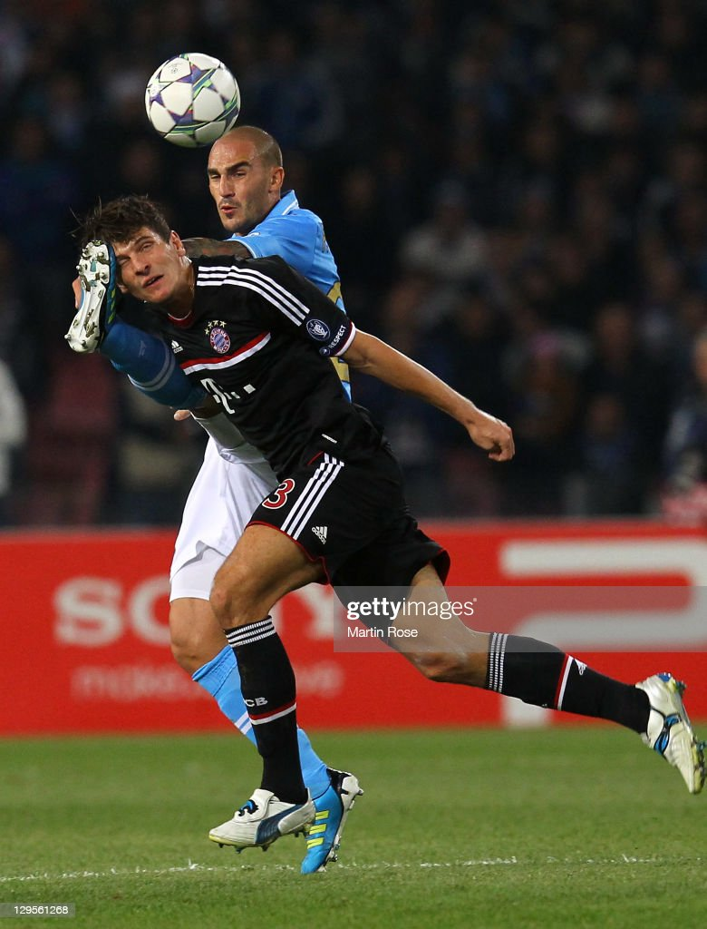 Paolo Cannavaro (back) of Naples and Mario Gomez (front) of Muenchen battle for the ball during the UEFA Champions League group A match between SSC Napoli and FC Bayern Muenchen at Stadio San Paolo on October 18, 2011 in Naples, Italy.
