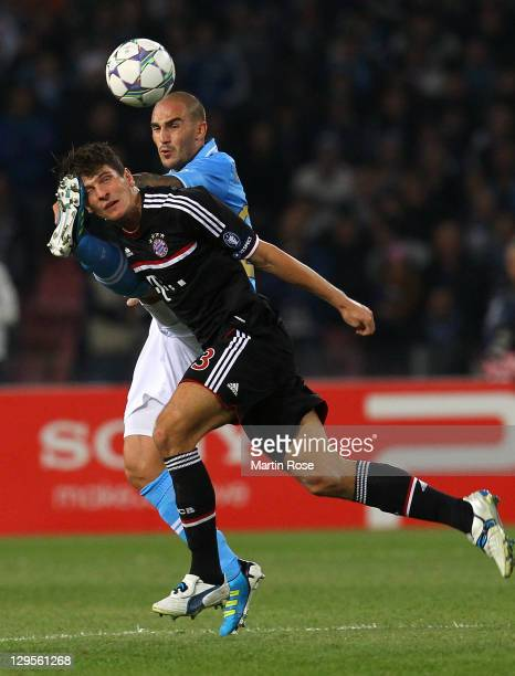 Paolo Cannavaro of Naples and Mario Gomez of Muenchen battle for the ball during the UEFA Champions League group A match between SSC Napoli and FC...