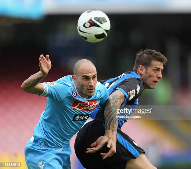 Paolo Cannavaro of Napoli competes for the ball in air with German Denis of Atalanta during the Serie A match between SSC Napoli and Atalanta BC at...