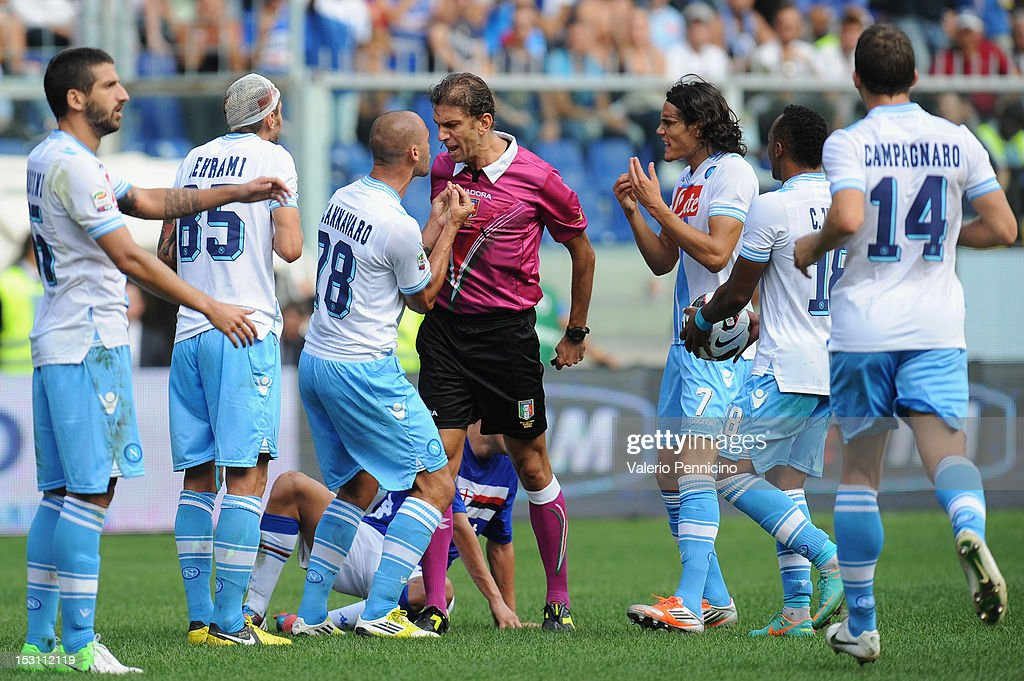 <a gi-track='captionPersonalityLinkClicked' href=/galleries/search?phrase=Paolo+Cannavaro&family=editorial&specificpeople=728856 ng-click='$event.stopPropagation()'>Paolo Cannavaro</a> of SSC Napoli reacts with referee PaoloTagliavento during the Serie A match between UC Sampdoria and SSC Napoli at Stadio Luigi Ferraris on September 30, 2012 in Genoa, Italy.