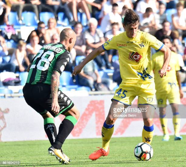 Paolo Cannavaro of US Sassuolo and Roberto Inglese of AC Chievo Verona in action during the Serie A match between US Sassuolo and AC Chievo Verona at...